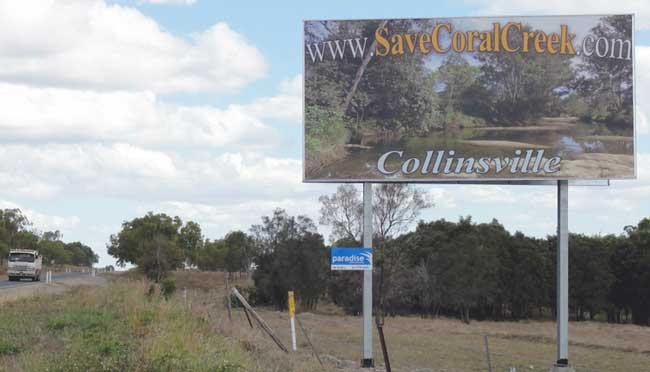 Save Coral Creek Billboard - distance view